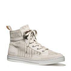 The Pita Sneaker from Coach. I love this perforated look and this color will go with any other color in your closet.