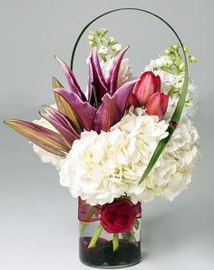 white hydrangea with lilies, tulips and stock