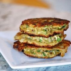 Zucchini fritters - one of my the most favourite summer dishes, perfect eaten cold and alone. Simple and delicious recipe - Zucchini Fritters by Mehan's Kitchen. Primal Recipes, Greek Recipes, Veggie Recipes, Real Food Recipes, Diet Recipes, Cooking Recipes, Yummy Food, Healthy Recipes, Protein Recipes