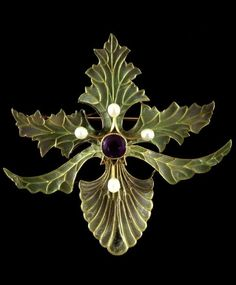 An Art Nouveau brooch, French, c.1900s, gold, set with amethysts, peridots, pearls, with plique-à-jour enamels.