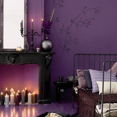 Purple Gothic inspired room ~ I like the candles in the fireplace!
