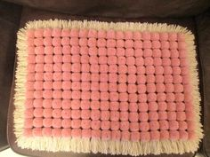 Butterfly,Lily loom pom pom blanket. For a cot sized blanket: 200gm wool in the fringe colour, 400gms in the pom pom colour.