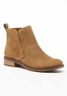 Casual yet sophisticated tan suede ankle bootie. So versatile and easy to style with denim to dresses!