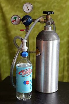 So much better looking than a soda stream. DIY Seltzer from Wonderland Kitchen Gas Supply, Milk Cans, Recycling Bins, Fire Extinguisher, Glass Containers, Summer Diy, Home Brewing, Plastic Bottles, Alcoholic Drinks