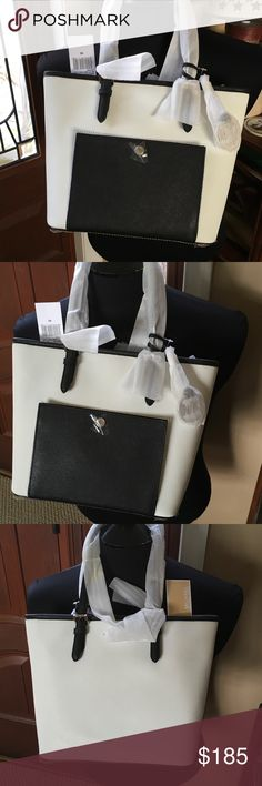 Michael Kors bag Brand new with tags Michael Kors  smaller Jet set bag in Black and White . Measures 8x10 beautiful bag and would make a great Christmas gift . KORS Michael Kors Bags Shoulder Bags