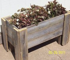 Price comparo.  smaller and not dressed as well as yours will be.  Recycled Cedar Planter Box w/legs by LLHDesigns on Etsy, $125.00