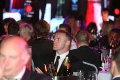 Manchester United captain Wayne Rooney seemed to have arrived without wife Coleen in what could be his last awards night