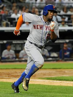 Eric Young Jr. #22 of the New York Mets runs the first base line after hitting a double in the top of the fifth inning during the game again...