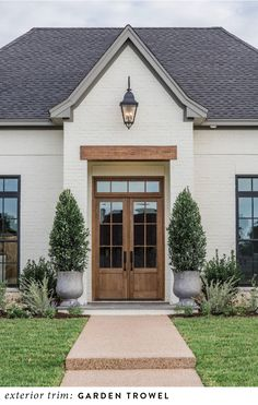Home Exterior Ideas 'Fixer Upper' Joanna Gains Reveals New Classic Style Home, modern farmhouse exterior with white painted brick and wood front door, double front door and farmhouse exterior lights and front porch decor with planters Design Exterior, Exterior Paint Colors, Exterior House Colors, Paint Colors For Home, Paint Colours, Fixer Upper Paint Colors, Exterior Houses, Exterior Shutters, Stucco Exterior