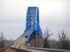 Irvin S. Cobb Bridge, linking Paducah, KY, and Brookport, IL; completed in 1943.