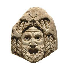 A ROMAN MARBLE TRAGIC THEATER MASK OF HERCULES CIRCA 1ST CENTURY A.D.