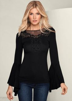 Billowy sleeves with intricate, embroidered details.