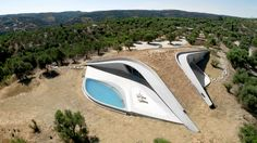 This Y-Shaped Greek Villa Looks Like a Flying Saucer That's Embedded Into the Hills - Dwell