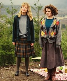 I love the skirt, sweater, and boots on the girl on the right - I only wish my…