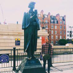 Intern by Statue of Sherlock Holmes in Britain