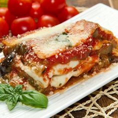 A delicious gooey layered eggplant recipe with layers of eggplant, delicious cheese and flavors that will tantalize your tastebuds.. Eggplant Parmigiana Recipe from Grandmothers Kitchen.