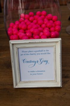 Charitable donation in lieu of favors, guests choose their fav charity-gumball ballots!