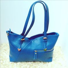 NEW Royal Blue Leather Handbag Beautiful color and perfect size to carry all your much needed items. Width is 14 inches height 10 inches and the base is 5 inches. Has plenty of pockets and compartments for storage. Does come with shoulder strap as pictured. Two available in royal blue color color. Bags Shoulder Bags