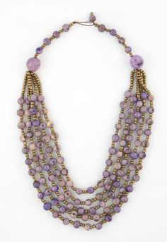 The eco-friendly, socially responsible TERRA Necklace is made from açai seeds and accented with gold beading. | lapucara.com