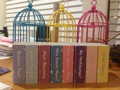 Mini birdcages and story books for display