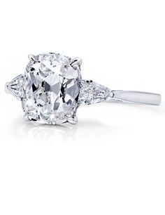 2.40 carat Cushion-Cut Three Stone Diamond Ring