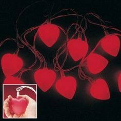 """Valentine Light Set Party Accessory by Fun Express. $14.99. Approved for indoor and outdoor use. High quality string lights. Extra bulbs included. 8 feet of lights. Light set includes (10) heart-shaped lights that measure 2"""" in diameter."""