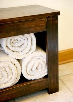 Simple spa bench- A good place for rolled towels, a good place to sit!