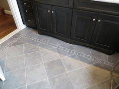 is darker than this appears. Master Suite, Master Bath, Shower Fixtures, Porcelain Tile, Slate, Tile Floor, Flooring, Bathroom, Gray