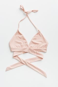 Blush pink seamless wrap around bikini top with halter bow-tie closure around the neck and back. Wrap around straps tie in the back to secure the fit. Made and manufactured in the USA at the highest q