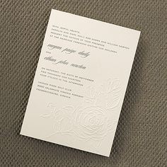 Embossed Rose wedding invitation Pretty roses are embossed on an ecru card with your custom wording printed flush left.