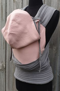 Custom asphalt grey linen half buckle with a pink panel and some cute mini carriers too. The carrier is a baby size with combination style shoulder straps, leg padding and a removable hoodie hood. #babywearing #babycarrier #customcarrier Babywearing, Baby Size, Shoulder Straps, Legs, Hoodies, Grey, Mini, Cute, Sweaters