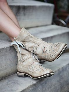 Distressed woven leather moccasin boots with woven leather ankle strap detailing. Leather ties at each outer side. Rubber lined sole. *By ...