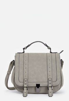 Sexy and chic, the Francois satchel features front buckle straps that are so on-trend right now! Features an adjustable top handle, front flap with foldover closure and an adjustable removable strap for flexibility....
