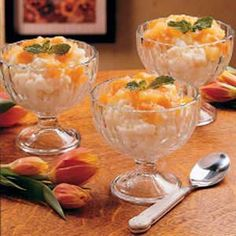 Apricot Rice Custard Recipe -Creamy rice custard drizzled with apricot sauce makes a comforting dessert or a refreshingly different breakfast. As a young mother, housewife and substitute teacher, I haven't been cooking all that long, but it's easy to impress people with this recipe since it's simple and delicious. -Elizabeth Montgomery, Allston, MA