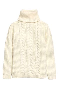 Camisola em malha de torcidos: Camisola em malha de mistura de algodão com textura. Frente em malha de torcidos, gola alta canelada e mangas compridas.