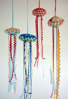 Handmade fabric jellyfish mobile using ribbons and ric-rac for the tentacles. Awesome!