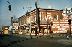 """A street view of retail stores along Hastings Street at the intersection of Mack Ave. In view is Morris Loan Office, a restaurant that featured """"chicken and shrimps,"""" Chase's Supermarket and an unidentified Hardware Store. State Of Michigan, Detroit Michigan, Detroit History, Paradise Valley, Urban Renewal, Urban City, Photo Story, Historic Homes, Back Home"""