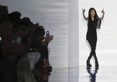 Fashion designer Vera Wang reacts to applause with thumbs up after showing her Spring 2014 collection on Tuesday, Sept. 10, 2013 in New York.