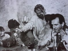 KUBRICK jokes with GAY HAMILTON on the set of BARRY LYNDON. The young girl on the far left is VIVIAN KUBRICK.