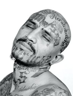 I do not condone prison or gang tattoos, but they are interesting in that, by taking the time to really look, the tattoos do tell incredible life stories. Mara Salvatrucha gang-member by Isabel Muñoz.