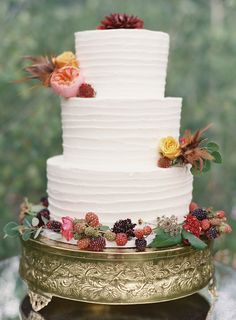 Three tier white wedding cake with flowers and berries   Bryce Covey Photography and Bluebird Productions   see more on: http://burnettsboards.com/2014/09/indian-summer-heat-wave-wedding/