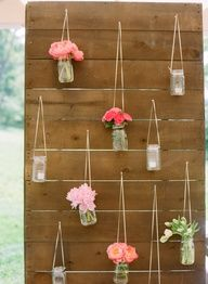flowers in mason jars on the wall