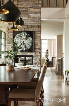 Take advantage of tall ceilings with groupings of long pendant lights, as designer Kimberley Seldon did in her own Creemore, Ontario, home. | Photographer: Donna Griffith