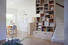 Awesome bookcase in a Swedish home, featured on Futurustic Blog.