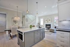 X Base Dining Table - Transitional - Kitchen - Benjamin Moore Kendall Charcoal - Fiorella Design Kitchen Island Microwave, Kitchen Island With Sink, Sink In Island, New Kitchen, Kitchen Ideas, Gray Island, Kitchen Design, Kitchen Reno, Kitchen Islands