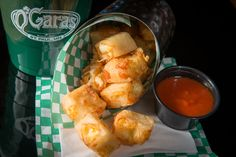 DEEP FRIED GRILLED CHEESE BITES: White cheddar cheese blended with beer batter, cubed and deep-fried for a taste reminiscent of a grilled cheese sandwich. Served with a bloody mary mix marinara. @ O'Gara's at the Fair (Minnesota State Fair 2016 New Food, mnstatefair.org)