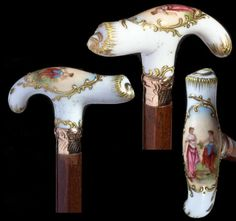 """Porcelain Dress Cane-Circa Sevres type dress cane with two hand-painted maidens, heavy moriage work, ornate gold filled collar, walnut shaft and a very ornate gold and metal ferrule-H. 3 ½"""" x 1 ½"""", O. Walking Sticks And Canes, Walking Canes, Porcelain Clay, Clay Flowers, Hand Painted, Needful Things, Cannes, Dining Rooms, Metal"""