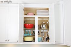 This post may contain affiliate links. Spring break means spring cleaning in my house. We recently took everything out of our cupboards to try to better organize it better. I Ended up buying THIS pot organzierand this dish rack–and then thought..Heck. Let's turn this into a full blown kitchen organization roundup! 1.Kitchen shelves with jars …