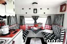 Gorgeous interior of small Glamper done in black and white and red polka dots and stripes