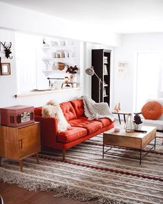 Image result for orange couch small living room